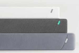 The three Tuft and Needle mattress models stacked on top of each other against a blank background.