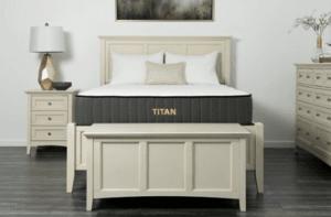 A Titan mattress in a neutral colored room.