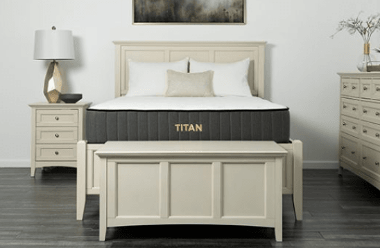 A Titan mattress in a neutral colored room.