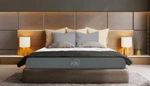 A Puffy Original mattress against a wooden bedroom.