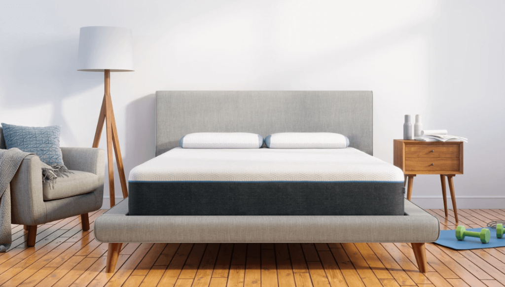 A gray and white Bear Pro mattress on a gray bed frame.