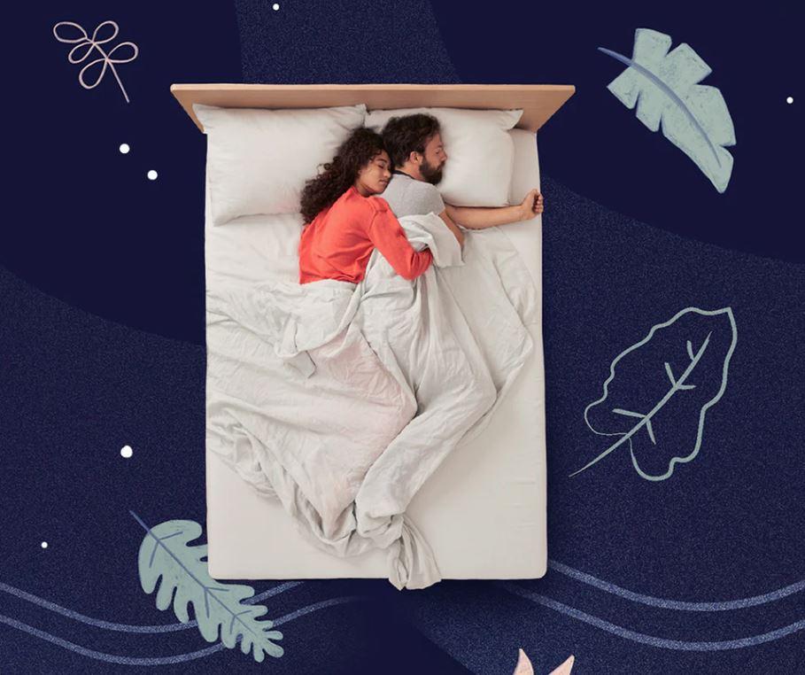A couple sleeping on a white Casper mattress.