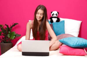 young slim woman using laptop