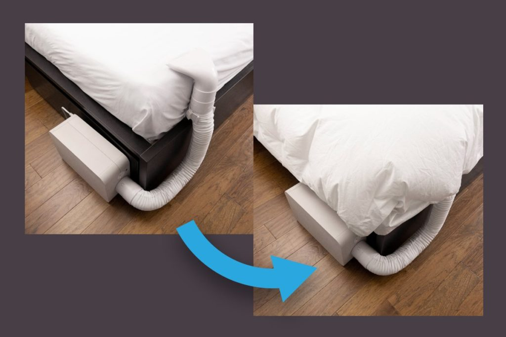 A white BedJet C-Clamp installed on a white bed sheet.