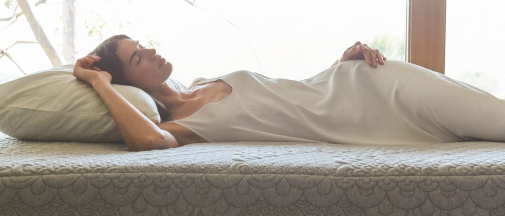 Woman laying on crystal cove mattress