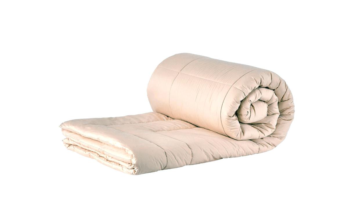 A rolled beige wool myMerino comforter.