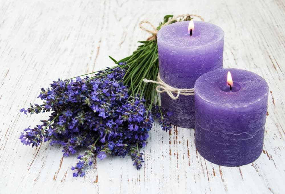 Lavender and candles on a old wooden background
