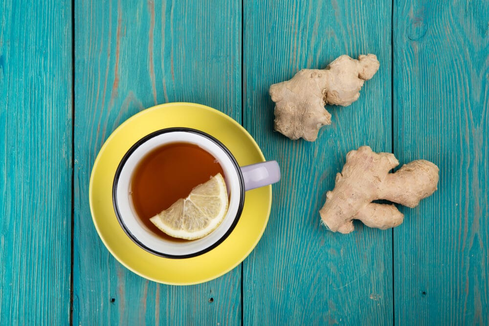 Ginger tea for sleep in a vintage cup on wooden background