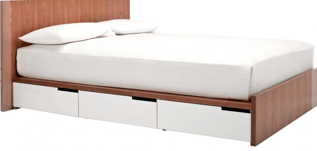 A wooden bed frame with white metal storage drawers and white sheets