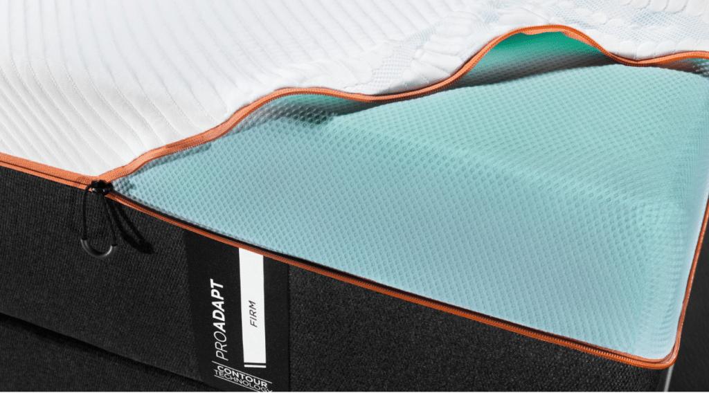 Tempur ProAdapt A dark gray and white mattress with a blue interior and an orange zipper