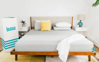 A white and gray Leesa Original mattress on a wooden bed frame.