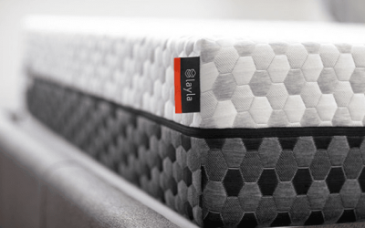 Close-up shot of the dual sided Layla mattress, shows light gray on top and dark gray on bottom.