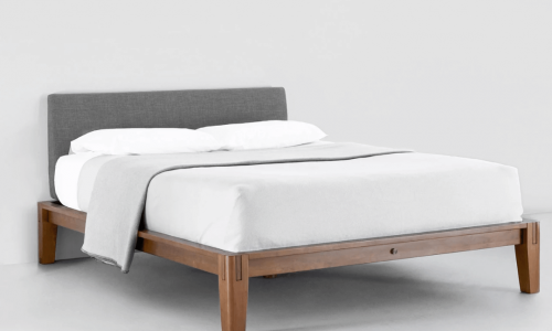 Thuma platform bed frame isolated against gray background.