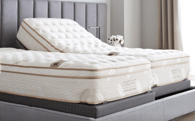 Two white Saatva mattresses on a gray bed frame.