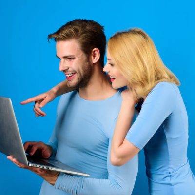 Online shopping. Online-shop. Smiling couple with laptop.