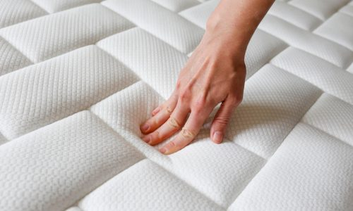 Cropped,Shot,Of,Young,Woman's,Hand,Testing,White,Orthopedic,Mattress